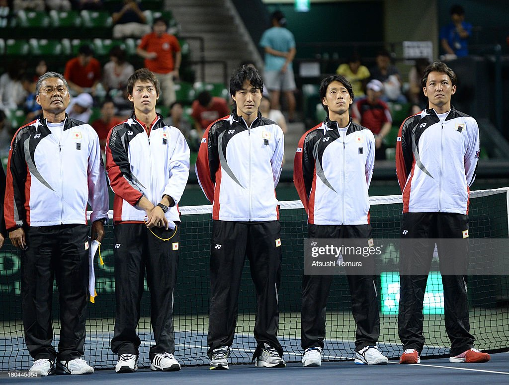 Members of the Japanese Davis Cup team (L to R) Minoru Ueda, <a gi-track='captionPersonalityLinkClicked' href=/galleries/search?phrase=Kei+Nishikori&family=editorial&specificpeople=4432498 ng-click='$event.stopPropagation()'>Kei Nishikori</a>, <a gi-track='captionPersonalityLinkClicked' href=/galleries/search?phrase=Go+Soeda&family=editorial&specificpeople=699644 ng-click='$event.stopPropagation()'>Go Soeda</a>, <a gi-track='captionPersonalityLinkClicked' href=/galleries/search?phrase=Yuichi+Sugita&family=editorial&specificpeople=2081175 ng-click='$event.stopPropagation()'>Yuichi Sugita</a> and <a gi-track='captionPersonalityLinkClicked' href=/galleries/search?phrase=Tatsuma+Ito&family=editorial&specificpeople=5545179 ng-click='$event.stopPropagation()'>Tatsuma Ito</a> lines up in the opening ceremony during day one of the Davis Cup World Group Play-Off at Ariake Colosseum on September 13, 2013 in Tokyo, Japan.