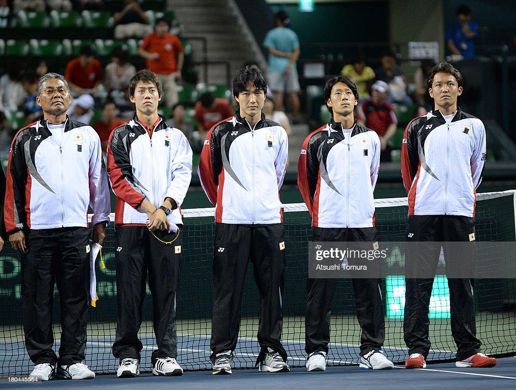 Members of the Japanese Davis Cup team Minoru Ueda Kei Nishikori Go Soeda Yuichi Sugita and Tatsuma Ito lines up in the opening ceremony during day...