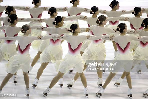 Members of the Japanese ice skating team 'Jingu Ice Messenger Grace' compete during the Senior short program of the French Cup synchronized ice...