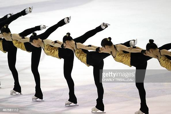 Members of the Japanese ice skating team 'Jingu Ice Messenger Grace' compete during the free skating competition of the French Cup synchronized ice...