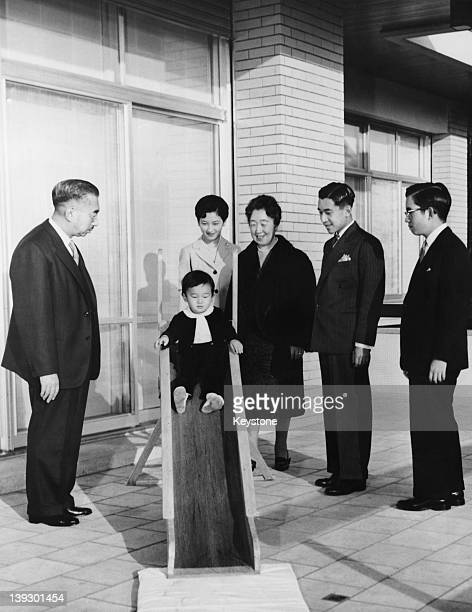 Members of the Japanese Imperial Family are photographed for their New Year's Day picture in the grounds of the Imperial Palace in Tokyo 27th...