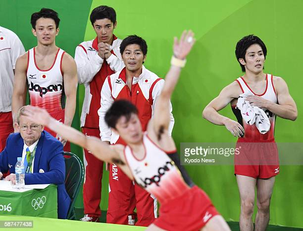 Members of the Japanese men's gymnastics team Yusuke Tanaka Kenzo Shirai Koji Yamamuro and Ryohei Kato watch floor exercise performance by teammate...