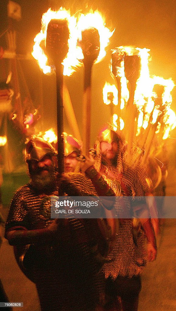 Members of the Jarl Viking Squad carry burning torches through the streets of Lerwick during the annual Up Helly Aa Festival Lerwick Shetland Islands...