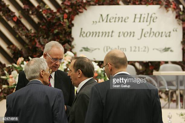 Members of the Jehova's Witnesses Church gather for a religious service March 24 2005 in Hennigsdorf Germany just outside of Berlin under a sign that...