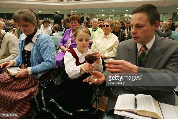 Members of the Jehova's Witnesses Church pass wine during a religious service March 24 2005 in Hennigsdorf Germany just outside of Berlin A Berlin...