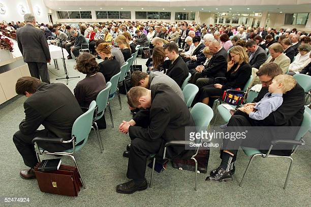 Members of the Jehova's Witnesses Church pray during a religious service March 24 2005 in Hennigsdorf Germany just outside of Berlin A Berlin court...