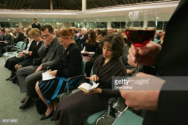 Members of the Jehova's Witnesses Church read from the Bible during a religious service March 24 2005 in Hennigsdorf Germany just outside of Berlin A...