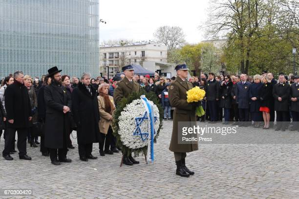 Members of the Jewish community lay flowers especially yellow daffodils that signify remembrance of the Warsaw Ghetto Uprising during the 74th...