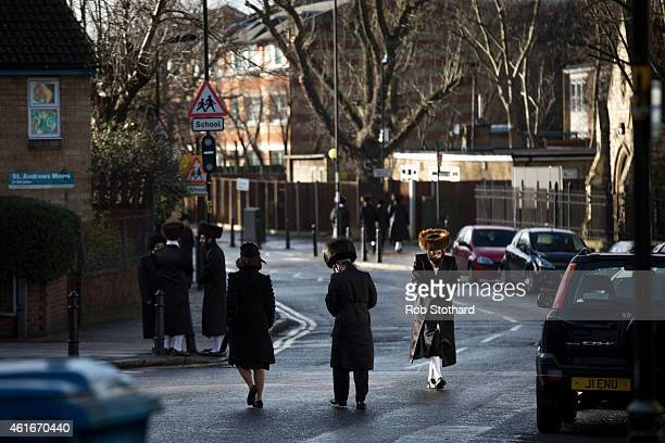 Members of the Jewish community walk across the street in the Stamford Hill area on January 17 2015 in London England Police have announced they will...
