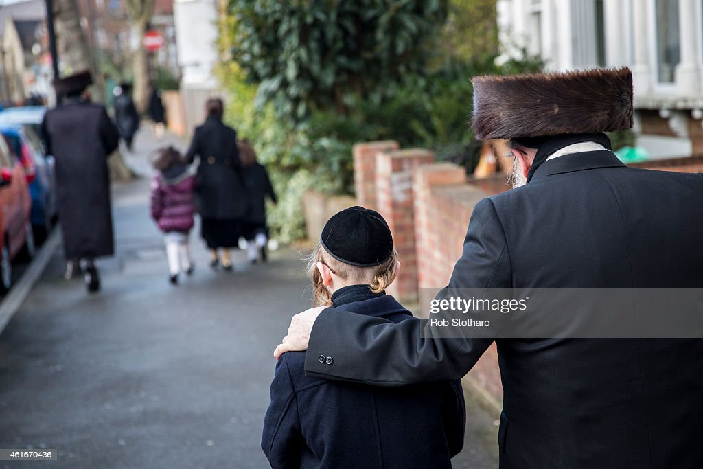 Members of the Jewish community walk along the street in the Stamford Hill area on January 17 2015 in London England Police have announced they will...