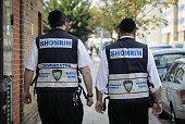Members of the Jewish 'Shomrim' security patrol team are pictured in north London on August 27 2014 The unusual sight of crimefighting Orthodox Jews...