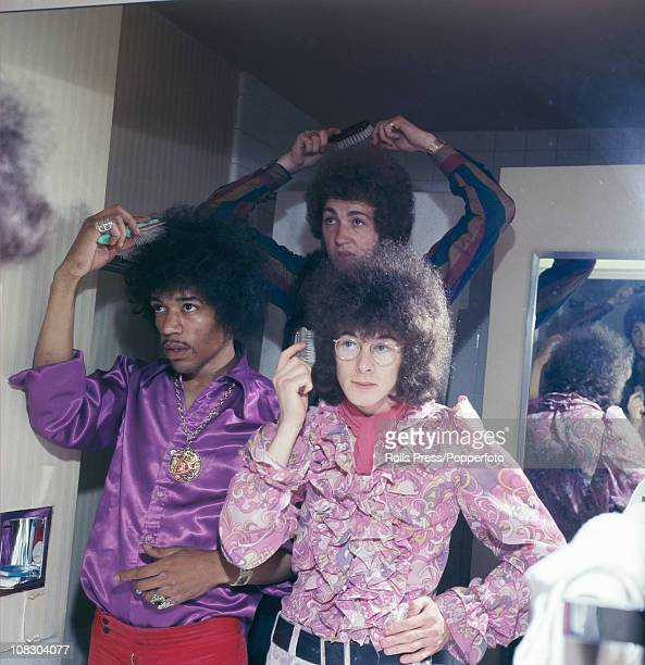Members of The Jimi Hendrix Experience doing their hair in a mirror circa 1968 Left to right Jimi Hendrix Mitch Mitchell and Noel Redding