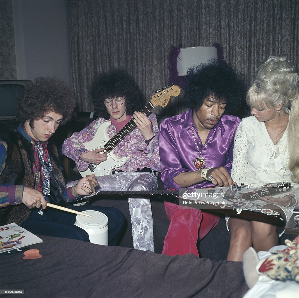 Members of The Jimi Hendrix Experience talking with a blionde lady circa 1968 Left to right Mitch Mitchell Noel Redding and Jimi Hendrix
