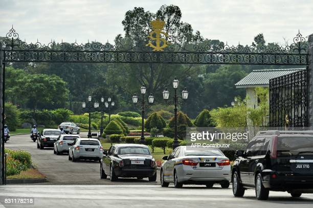 Members of the Johor royal family travelling in their motorcade arrive at the Istana Bukit Serene palace in Johor Bahru on August 14 for the wedding...