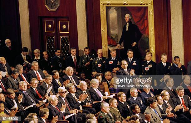 Members of the Joint Chambers of Congress listen to President Bill Clinton's State of the Union speech on January 20 1999 Standing in the middle is...