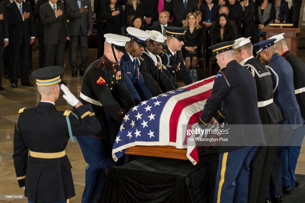 DECEMBER 20 -- Members of the Joint Military Honor Guard carry place the casket of Senator Daniel Inouye (D-HI) in place at the Capitol Rotunda on Capitol Hill in Washington, D.C., on Thursday, December 20, 2012. Inouye, President Pro Tempore of the the United States Senate will lie in state until Friday before a funeral service at the Washington National Cathedral.
