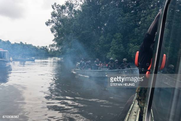 Members of the Joint Task Force Operation Delta Safe are seen on patrol in the creeks looking for illegal oil refineries on April 19 2017 in the...