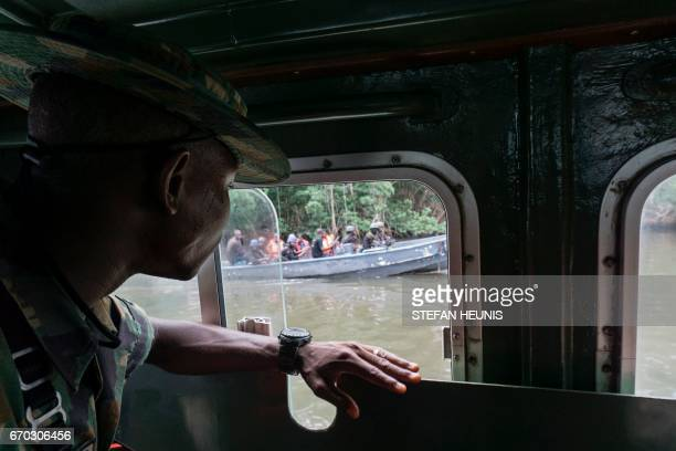 TOPSHOT Members of the Joint Task Force Operation Delta Safe are seen on patrol in the creeks looking for illegal oil refineries on April 19 2017 in...