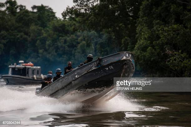 Members of the Joint Task Force Operation Delta Safe on patrol in the creeks looking for illegal oil refineries on April 19 2017 in the Niger Delta...