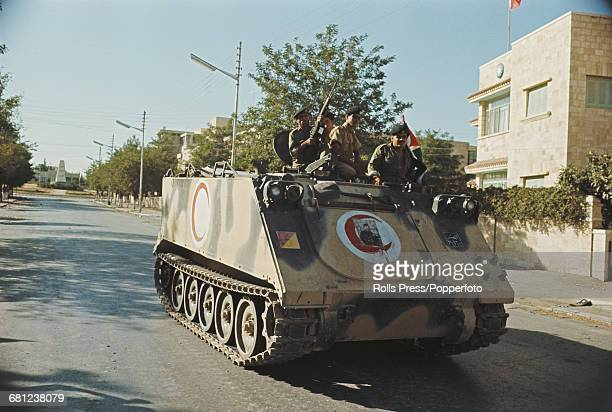 Members of the Jordanian military and army ride in a M113 armored personnel carrier on patrol in Amman Jordan following a period of fighting between...