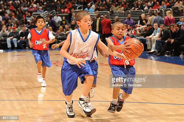 Members of the Jr Clippers scrimmage during halftime of the game between the Toronto Raptors and the Los Angeles Clippers at Staples Center on...
