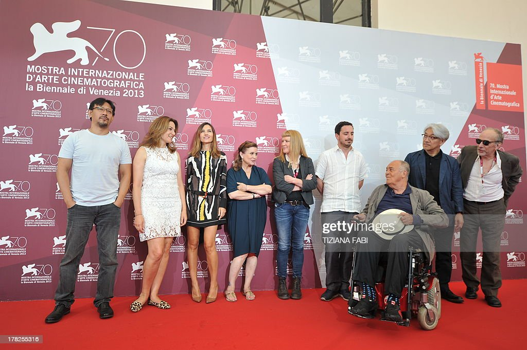 Members of the Jury, (from left) Chinese actor and director Jiang Wen, German actress Martina Gedeck, French actress Virginie Ledoyen, US actress and scriptwriter Carrie Fisher, British director Andrea Arnold, Chilean director, screenwriter and producer Pablo Larrain, Italian director and president of the jury Bernardo Bertolucci, Japanese composer, musician and producer Ryuichi Sakamoto and Swiss French director of photography Renato Berta pose during a photocall at the Lido Casino on the first day of the 70th Venice Film Festival on August 28, 2013 at Venice Lido.