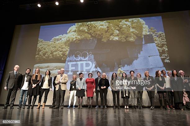 Members of the jury gather during the opening of the 30th annual FIPA in Biarritz on January 24 2017 / AFP / IROZ GAIZKA