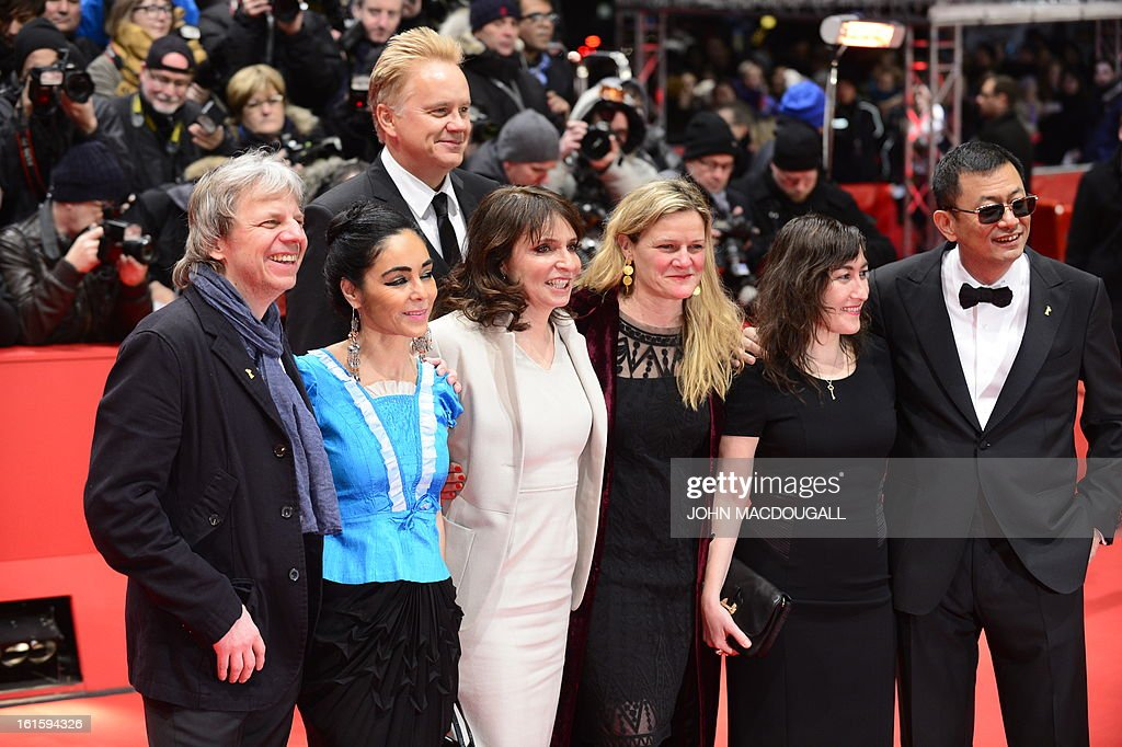 Members of the jury,(from L to R) German director Andreas Dresen,Iranian director Shirin Neshat, Danish director Susanne Bier, US actor and director Tim Robbins, US cinematographer Ellen Kuras, Greek director Athina Rachel Tsangari, Jury president Hong Kong Chinese director Wong Kar-Wai pose for photographers on arrival for the premiere of the film 'Side Effects' presented in the Berlinale Competition of the 63rd Berlin International Film Festival in Berlin on February 12, 2013.