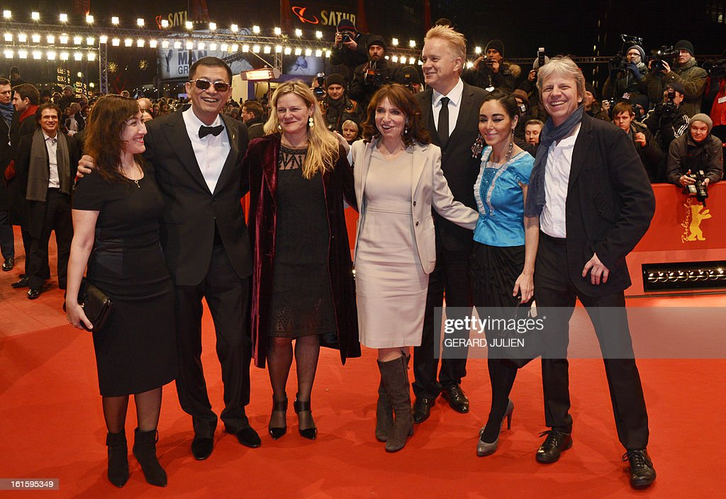 Members of the jury, (from R to L) German director Andreas Dresen,Iranian director Shirin Neshat, Danish director Susanne Bier, US actor and director Tim Robbins, US cinematographer Ellen Kuras, Greek director Athina Rachel Tsangari, Jury president Hong Kong Chinese director Wong Kar-Wai pose for photographers on arrival for the premiere of the film 'Side Effects' presented in the Berlinale Competition of the 63rd Berlin International Film Festival in Berlin on February 12, 2013.