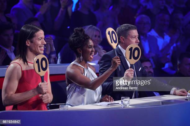 Members of the jury Jorge Gonzalez Motsi Mabuse and Joachim Llambi give 30 points to Gil Ofarim and Ekaterina Leonova during the 3rd show of the...