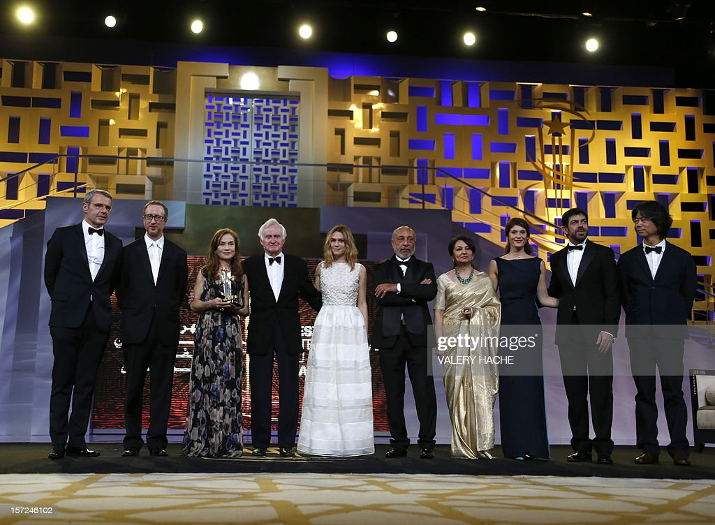 Members of the jury (from L to R), Lambert Wilson, James Gray, Isabelle Huppert, John Boorman, Marie-Josee Croze, Jillali Ferhati, Sharmila Tagore, Gemma Arterton, Pierre Francesco Favino and Jeon Soo Il pose during the opening ceremony of the 12th Marrakesh International Film Festival on November 30, 2012 in Marrakesh.