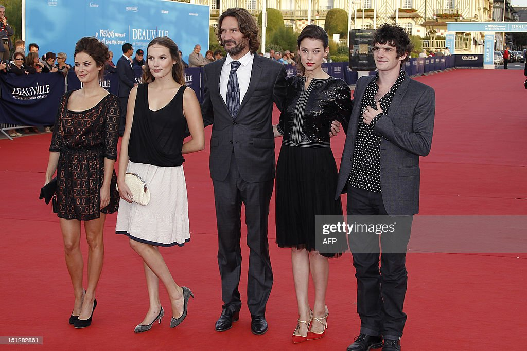 Members of the Jury 'Revelation', French actress Melanie Bernier (L), French actress Ana Girardot (2nd L), President of the Jury 'Revelation' and French writer Frederic Beigbeder (C), French actress Astrid Berges Frisbey (2nd R), and French actor Felix Moati (R) pose on the red carpet before the screening of the movie 'Lawless' on September 5, 2012, during the 38th US Film Festival, in the French northwestern sea resort of Deauville.