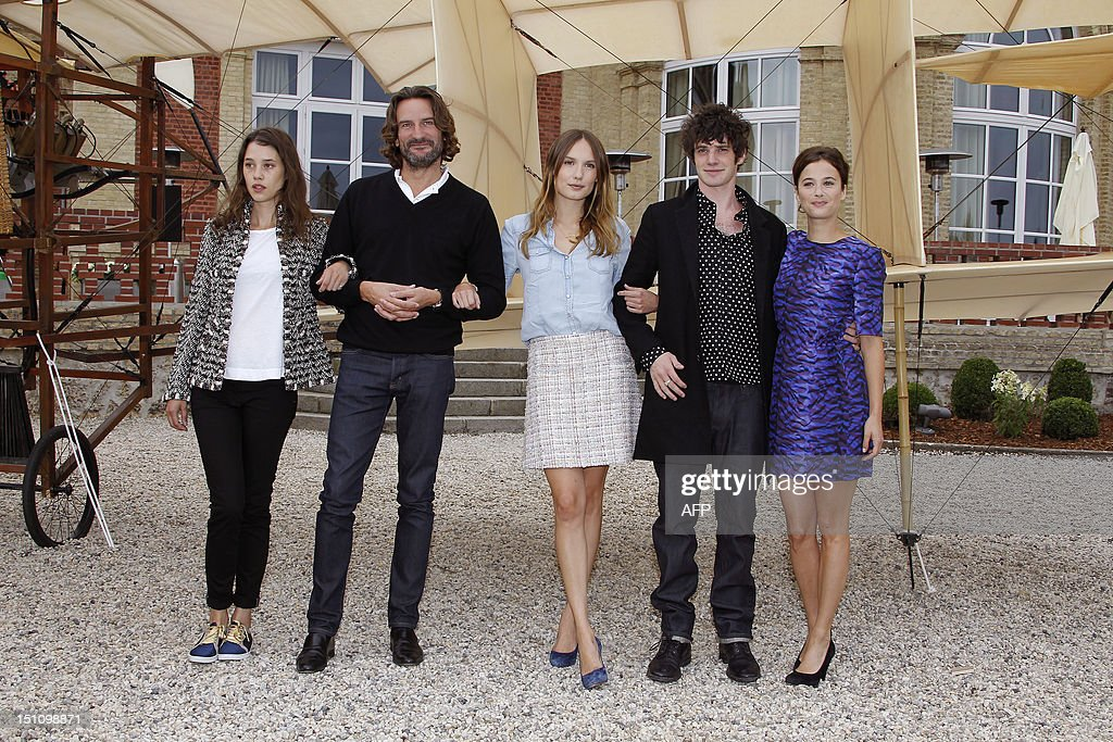 Members of the Jury 'Revelation', French-Spanish actress Astrid Berges-Frisbey (L), president of the Jury and writer Frederic Beigbeder (2ndL), actress Ana Girardot (C), actor Felix Moati (2ndR), and actress Melanie Bernier (R) pose during a photocall in 'La Villa Cartier' during the 38th Deauville's US Film Festival, in the French northwestern searesort of Deauville, on September 1, 2012. AFP PHOTO / CHARLY TRIBALLEAU