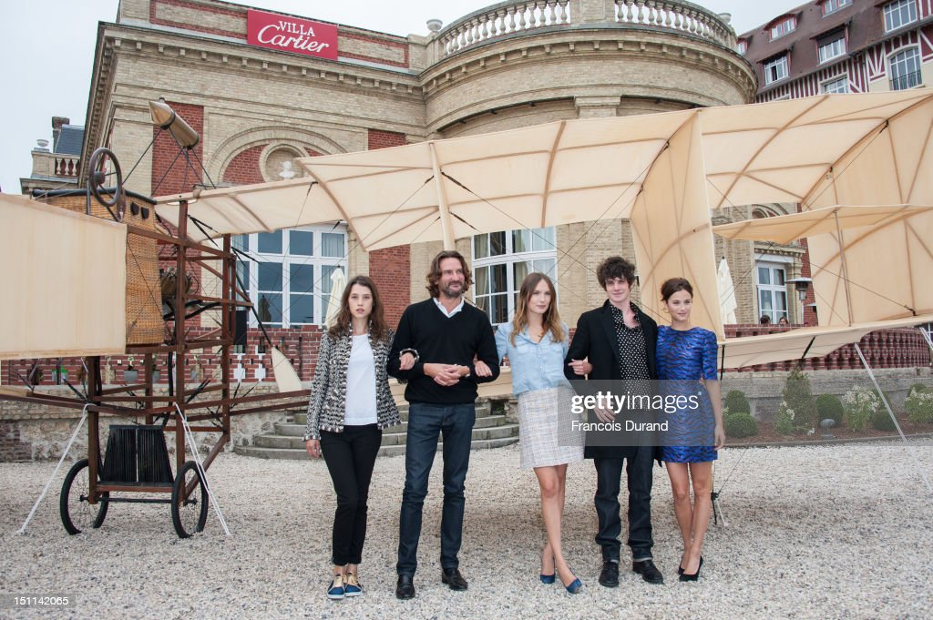 Members of the Jury 'Revelation', French-Spanish actress Astrid Berges-Frisbey (L), president of the Jury and writer Frederic Beigbeder (2ndL), actress Ana Girardot (C), actor Felix Moati (2ndR), and actress Melanie Bernier (R) pose during a photocall in 'La Villa Cartier' during the 38th Deauville American Film Festival on September 1, 2012 in Deauville, France.