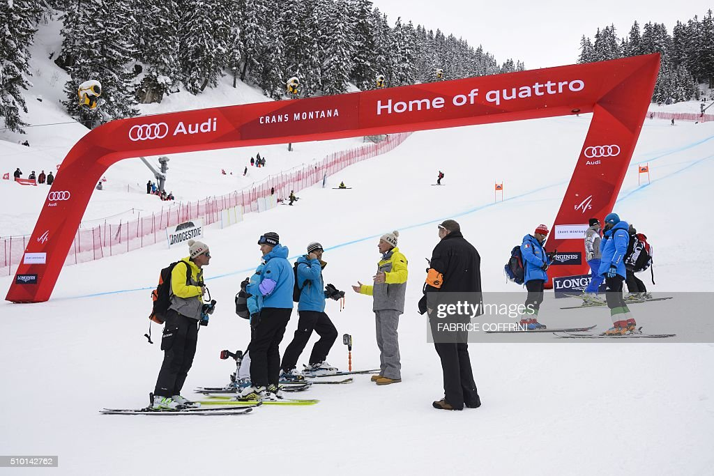 Members of the jury stand in the arrival area of the women's downhill race at the FIS Alpine Skiing World Cup in Crans-Montana, on February 14, 2016. The women's World Cup downhill in Crans-Montana re-scheduled for February 14 was cancelled because of heavy snow. / AFP / FABRICE COFFRINI