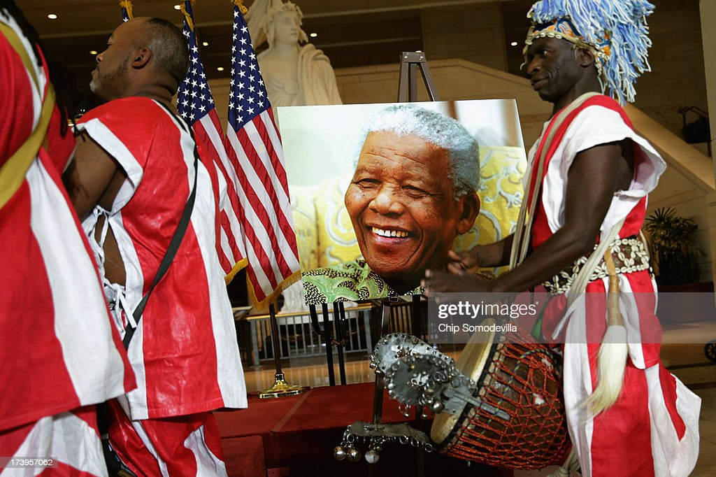Members of the Kankouran West African Dance Company perform at the beginning of a ceremony to celebrate the life Nobel Peace Prize laureate and former South Africa President Nelson Mandela on the occasion of his 95th birthday in the U.S. Capitol Visitor Center July 18, 2013 in Washington, DC. July 18 is Nelson Mandela Day, during which people are asked to give 67 minutes of time to charity and service in their community to honor the 67 years Mandela gave to public service. Mandela was admitted to a South African hospital June 8 where he is being treated for a recurring lung infection.