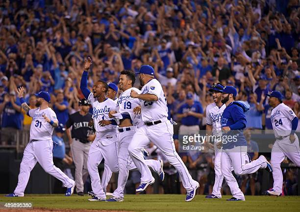 Members of the Kansas City Royals celebrate after clinching the American League Central Division title at Kauffman Stadium on September 24 2015 in...