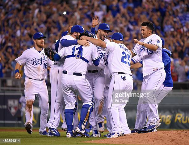 Members of the Kansas City Royals celebrate after taking the American League Central Division title at Kauffman Stadium on September 24 2015 in...