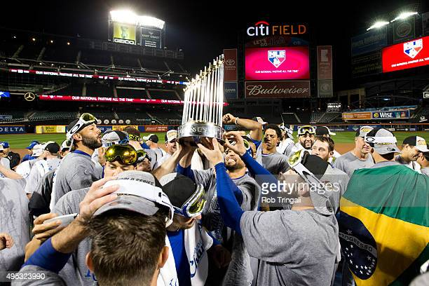 Members of the Kansas City Royals hoist up the Commissioner's Trophy on the field after defeating the New York Mets in Game 5 of the 2015 World...