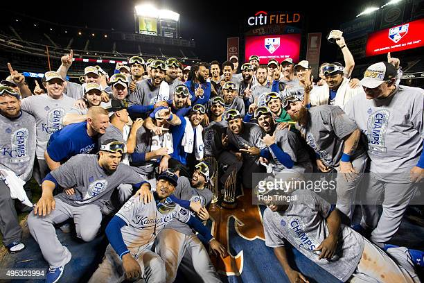 Members of the Kansas City Royals take team photo on the field after defeating the New York Mets in Game 5 of the 2015 World Series at Citi Field on...