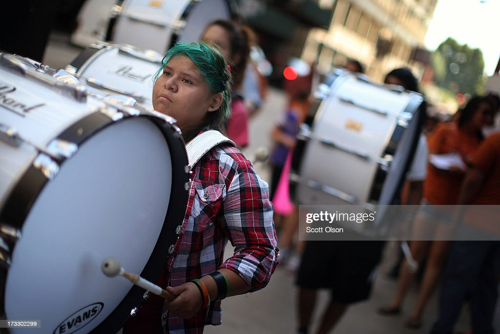 Members of the Kelly High School marching band drum line lead demonstrators to the Chicago Public Schools headquarters to protest funding and staff cuts to their neighborhood schools on July 11, 2013 in Chicago, Illinois. Earlier this year Chicago Public Schools announced it will close more than 50 elementary schools shifting 30,000 students and eliminating or relocating 1,000 teaching jobs as the school board tries to rein in a looming $1 billion budget deficit.