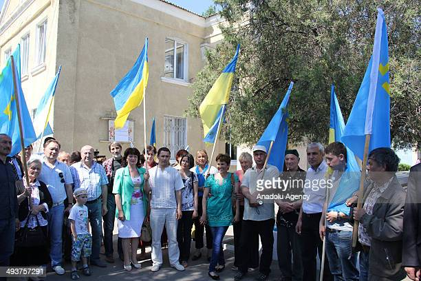Members of the Kherson Regional Council welcome Crimean Tatar Turks arrived at Kherson region to cast their ballots at a polling station during...