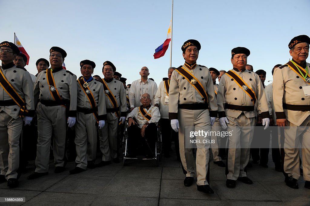 Members of the Knights of Rizal pay their respects at the monument of Philippine national hero Jose Rizal during a ceremony marking the 106th anniversary of his death at the Luneta Park in Manila on December 30, 2012. Rizal was sentenced to death by a firing squad of the Spanish army after he was accused of leading a revolution against Spain.
