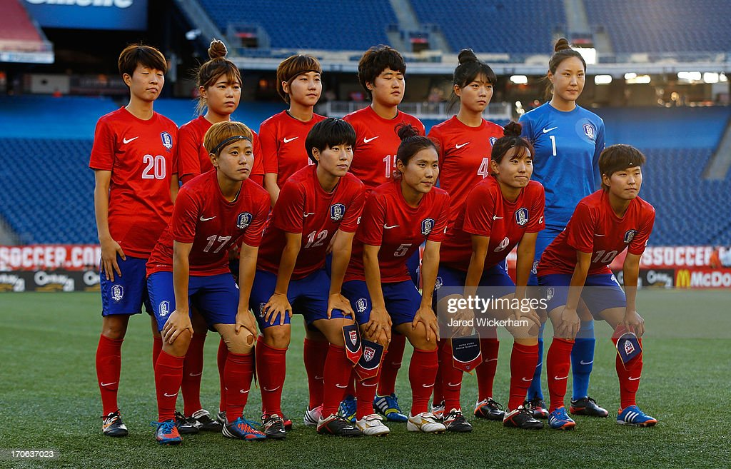 Members of the Korea Republic pose for a photo prior to the game against the US Womens National team at Gillette Stadium on June 15, 2013 in Foxboro, Massachusetts.