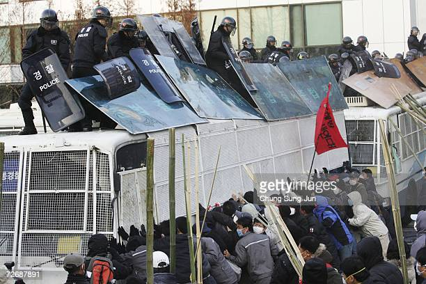 Members of the Korean Confederation of Trade Unions clash with riot police during an antigovernment protest in front of the National Assembly on...