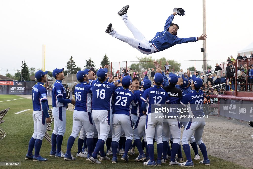 Members of the Korean National team celebrate prior to the medal ceremony during the WBSC U-18 Baseball World Cup at Port Arthur Stadium on September 10, 2017 in Thunder Bay, Canada.