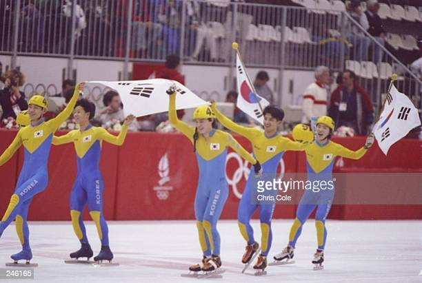 Members of the Korean speed skating team celebrate after winning the men''s 5000 meter relay during the Olympic Games in Albertville France