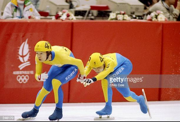 Members of the Korean speed skating team skate around the ice during the men''s 5000 meter relay during the Olympic Games in Albertville France Korea...