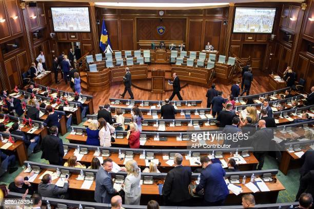 Members of the Kosovo parliament leave after a parliament session in Pristina on August 3 2017 Kosovo parliament failed on August 3 to elect its...