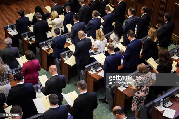 Members of the Kosovo parliament take oath during a parliament session in Pristina on August 3 2017 Kosovo parliament failed on August 3 to elect its...